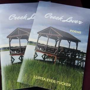 Cover image of Creek Lover, chapbook. Image includes two copies of the book, with a picture of a creek dock and the marsh on the cover.