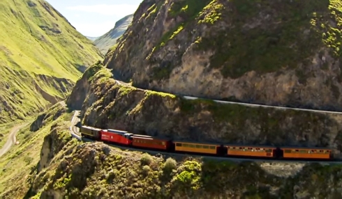 old fashioned train through an Andean valley